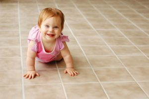 Reasons to Hire Professional Tile and Grout Cleaning - baby on clean tile