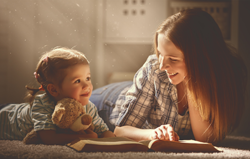 Carpet Care Tips - Woman and child reading on carpet