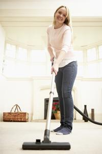 Carpet Care Tips - Woman Vacuuming
