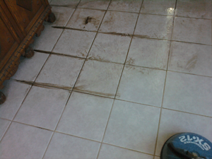 Professional tile and grout cleaning showing before and after